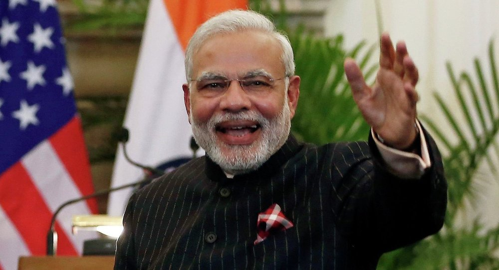 U.S. President Barack Obama stands next to Indian Prime Minister Narendra Modi (R) waving as they leave after giving their opening statement at Hyderabad House in New Delhi January 25, 2015