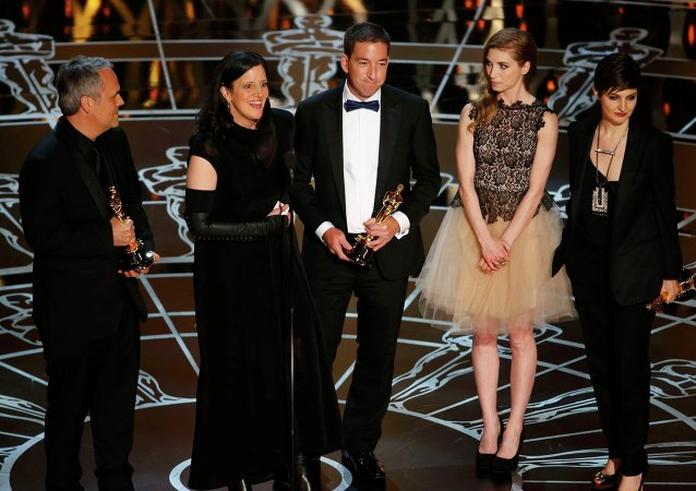 Laura Poitras (2nd L) speaks after accepting the Oscar along with colleagues for Best Documentary Feature for Citizenfour at the 87th Academy Awards in Hollywood, California February 22, 2015.