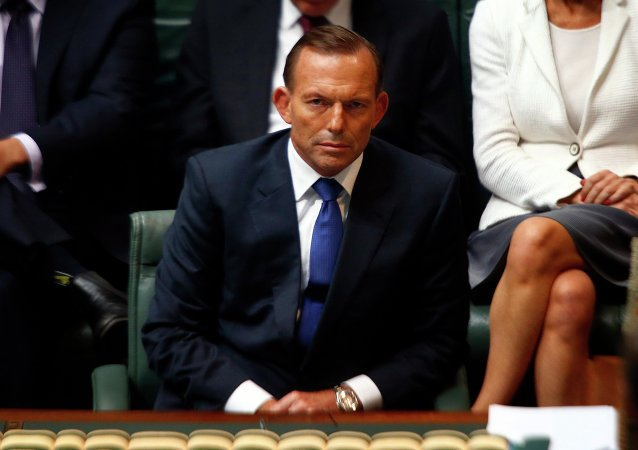 Australian Prime Minister Tony Abbott listens to a question in the Australian Parliament located in the Australian capital city of Canberra February 23, 2015