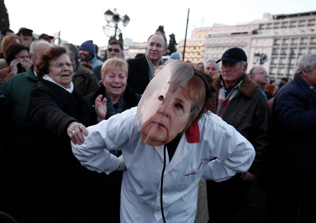 A performer impersonating German Chancellor Angela Merkel takes part in a performance outside Greece's parliament to support the newly elected government's push for a better deal on Greece's debt, in central Athens, on Sunday, Feb. 15, 2015