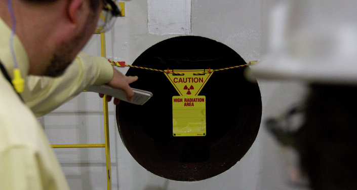 US federal state regulators warned about a radioactive uranium leak that occurred at a nuclear fuel plant in South Carolina.  Above: Reporters point to a hole in the wall with a radioactive warning on it near the containment vessel of the Unit 1 reactor during a tour of the Browns Ferry nuclear plant in Athens, Ala., Friday, March 25, 2011