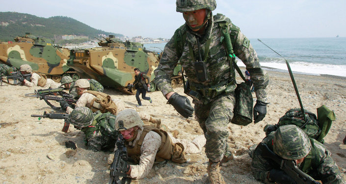 South Korean and U.S. Marines participate in the U.S.-South Korea joint landing exercises called Ssangyong, part of the Foal Eagle military exercises, in Pohang, South Korea, Monday, March 31, 2014