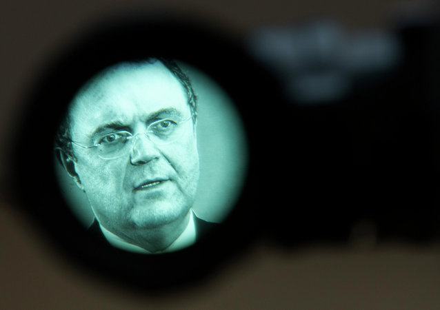 German Interior Minister Hans-Peter Friedrich seen through a television camera view finder as he briefs the media in Berlin