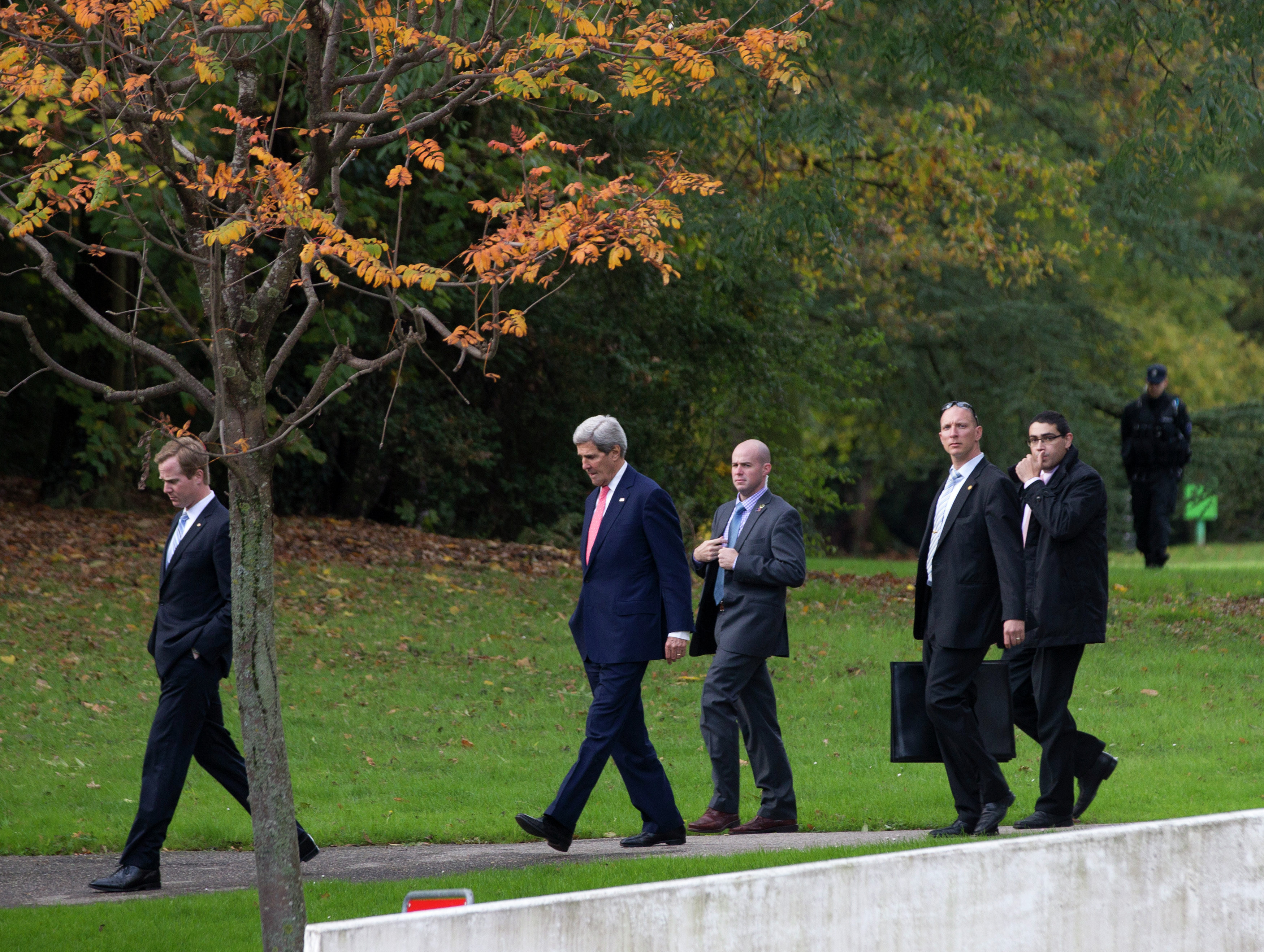 U.S. Secretary of State John Kerry, second left, walks in the grounds of the Intercontinental Hotel in Geneva, Switzerland, before a meeting with EU High Representative for Foreign Affairs, Catherine Ashton and Iranian Foreign Minister Mohammad Javad Zarif, Saturday Nov. 9, 2013.