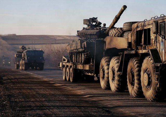 Military trucks from the Ukrainian armed forces transport tanks on the road near Artemivsk, eastern Ukraine, February 24, 2015