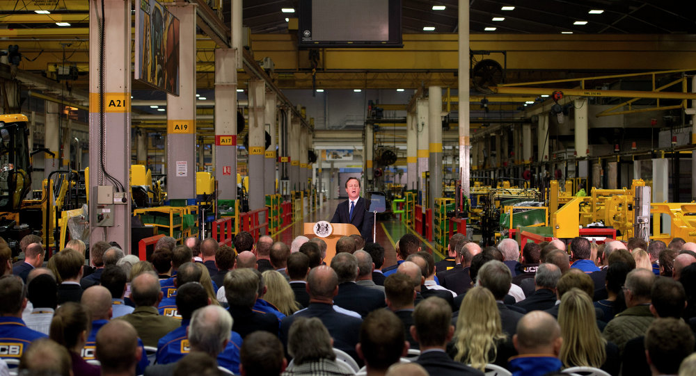 British Prime Minister David Cameron, background centre, delivers a speech on immigration to factory workers and members of the media, at JCB World Headquarters in Rocester, central England