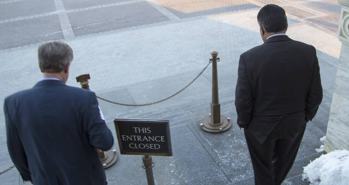 Members of the House of Representatives depart the House floor to an outdoor exit after a failed afternoon vote on a measure to fund the Department of Homeland Security at the Capitol in Washington