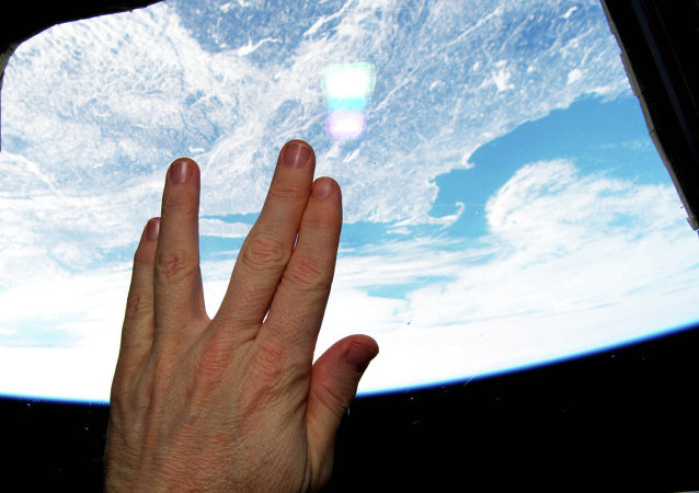 NASA astronaut Terry Virts gives the Vulcan salute from the International Space Station in tribute to Leonard Nimoy