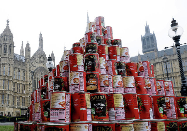 A pyramid of 468 cans of soup, which represents a seven-fold increase in the number of British people who make use of Food Banks since the current British coalition government came to power in 2010.