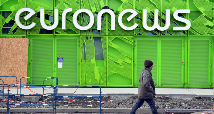 A photo taken on February 6, 2014 shows a man walking past the Euronews building in Lyon's new Confluence district
