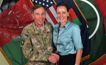 Former Commander of International Security Assistance Force and U.S. Forces-Afghanistan Gen. Davis Petraeus, left, shaking hands with Paula Broadwell, co-author of All In: The Education of General David Petraeus. Petraeus resigned as CIA director over his extramarital affair with his biographer, Broadwell.