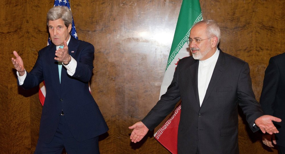 U.S. Secretary of State John Kerry (L) and his Iranian counterpart Mohammad Javad Zarif discuss seating arrangements for a meeting during a new round of nuclear negotiations in Montreux March 2, 2015