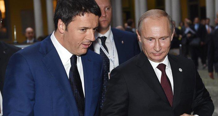 Italian Prime Minister Matteo Renzi, left, talks with Russian President Vladimir Putin. File photo