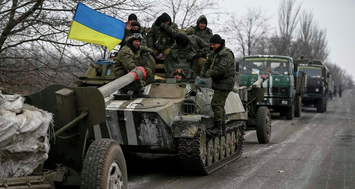 A convoy of Ukrainian armed forces including armoured personnel carriers, military vehicles and cannons prepare to move as they pull back from the Debaltseve region, in Paraskoviyvka, eastern Ukraine, February 26, 2015