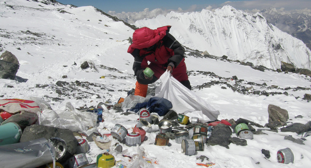 This picture taken on May 23, 2010 shows a Nepalese sherpa collecting garbage, left by climbers, at an altitude of 8,000 metres during the Everest clean-up expedition at Mount Everest