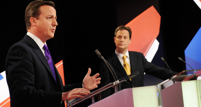 Conservative leader David Cameron, left, and Liberal Democrat Party leader Nick Clegg, centre, take part in Britain's second televised election debate in Bristol, England, Thursday, April 22, 2010.