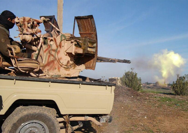 In this image posted on a militant social media account by the Al-Baraka division of the Islamic State group on Tuesday, Feb. 24, 2015, a fighter fires a heavy weapon mounted on the back of a pickup truck during fighting in Tal Tamr, Hassakeh province, Syria