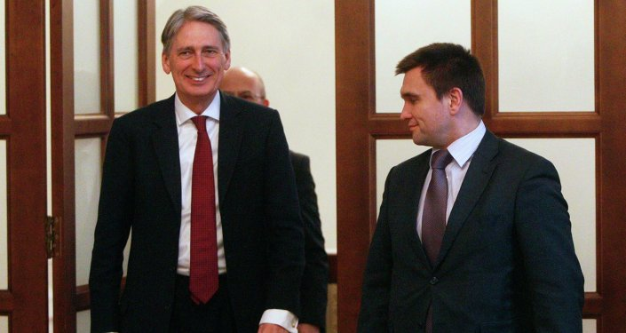 British Foreign Secretary Philip Hammond (L) walks with Ukraine's Foreign Minister Pavlo Klimkin prior to their meeting in Kiev March 5, 2015