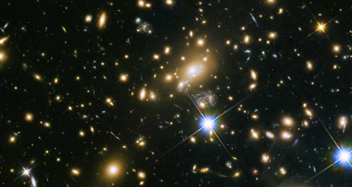An example of a galaxy cluster: the galaxy cluster MACS J1149.5+223, whose light took over 5 billion years to reach us.