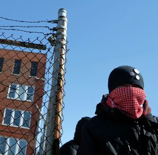A protestor stands outside a police facility called Homan Square, demanding an investigation into a media report denied by police that the site functions as an off-the-books interrogation compound, in Chicago, Illinois, March 5, 2015