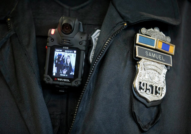 A Philadelphia Police officer demonstrates a body-worn camera