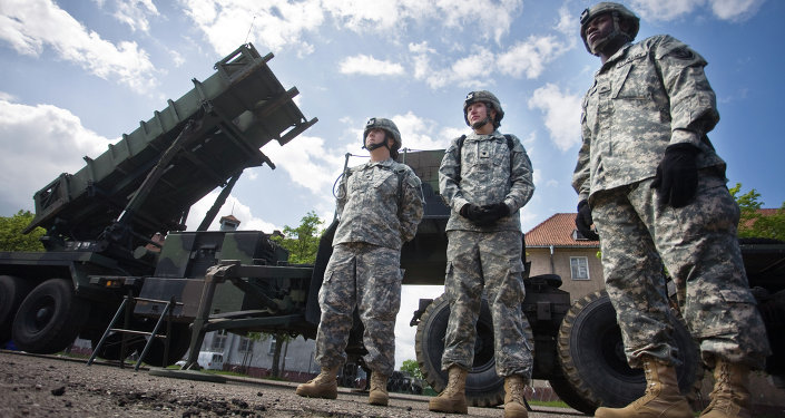 US soldiers stand on May 26, 2010 in front of a Patriot missile battery at an army base in the northern Polish town of Morag.
