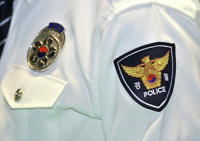 A logo of South Korean National Police Agency is seen on an arm of a policeman