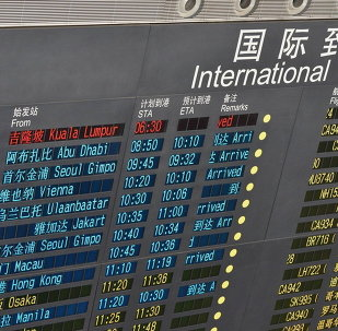 A message is seen to show the delayed arrival of the missing Malaysian flight on an electronic board at the Beijing Capital International Airport in Beijing, capital of China