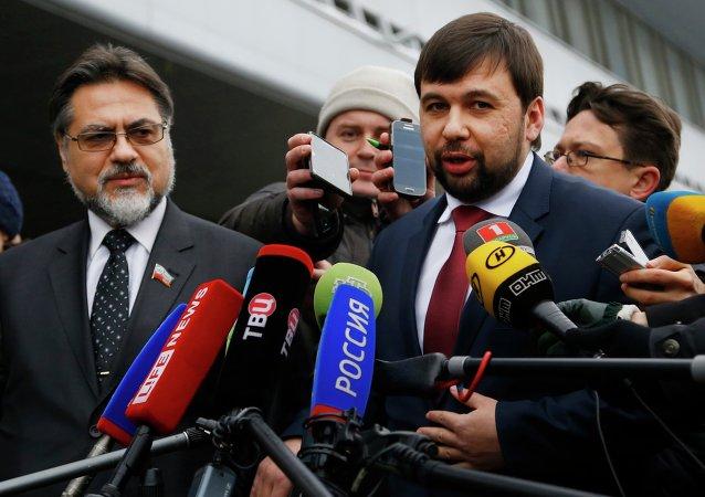 Representatives of the Donetsk and Lugansk People's Republics Denis Pushilin, right, and Vladislav Deinego