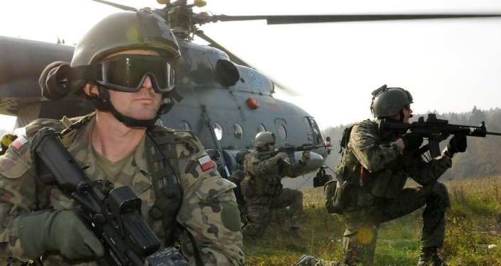 A Polish Special Operations Forces Command soldier, left, provides security alongside U.S. Special Forces Soldiers before exfiltrating on a Lithuanian Mi-17 helicopter as part of a downed aircraft exercise rehearsal held Oct. 14 at the Joint Multinational Readiness Center in Hohenfels, Germany.