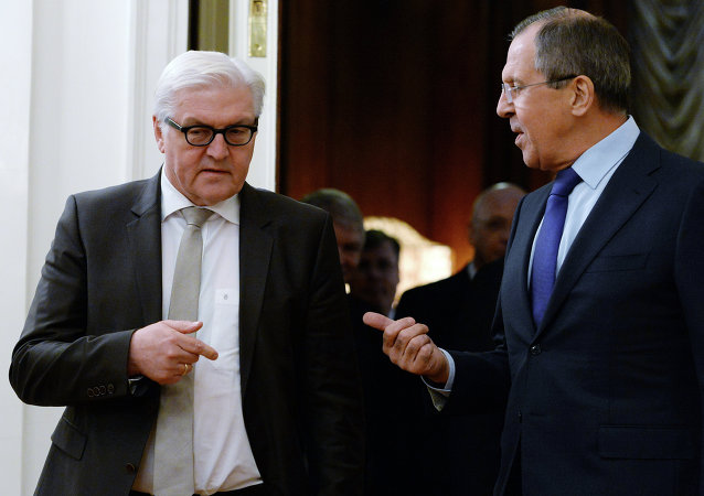 Russian Foreign Minister Sergei Lavrov (R) speaks with his German counterpart Frank-Walter Steinmeier.