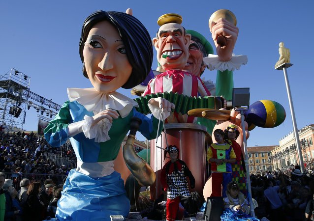 A float named Hit the road Jack depicting (From L) current French Culture minister Fleur Pellerin, and former French Culture ministers Frederic Mitterrand and Jack Lang, parades during the Nice Carnival on February 22, 2015 in Nice, southeastern France