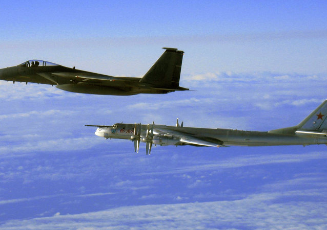 This Thursday, Sept. 28, 2006 file photo provided by the U.S. Air Force shows an F-15C Eagle from the 12th Fighter Squadron at Elmendorf Air Force Base in Anchorage, Alaska, flying next to a Russian Tu-95 Bear bomber, right, during a Russian exercise which brought the bomber near the west coast of Alaska
