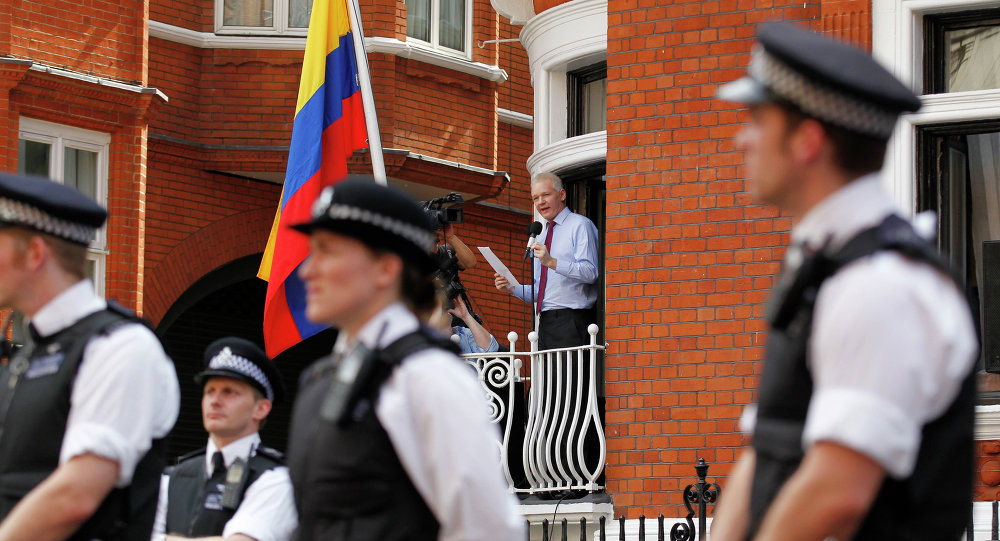 Surrounded by British police WikiLeaks founder Julian Assange, centre, makes a statement to the media and supporters from a window of Ecuadorian Embassy in central London.