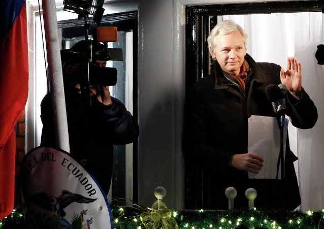 WikiLeaks founder Julian Assange gestures from the balcony of Ecuador's Embassy as he makes a speech in central London, in this file photograph dated December 20, 2012