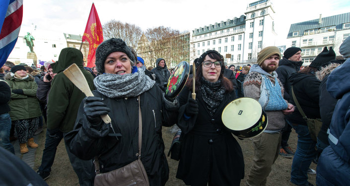 Thousands of protesters gather in front of teh Parliament in the Icelandic capital Reykjavik on February 24, 2014
