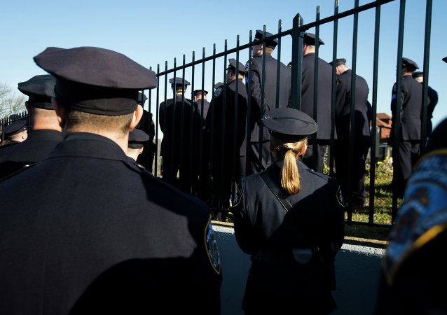 Police officers turn their backs as New York City Mayor Bill de Blasio speaks at the funeral of New York city police officer Rafael Ramos in the Glendale section of Queens, Saturday, Dec. 27, 2014, in New York.