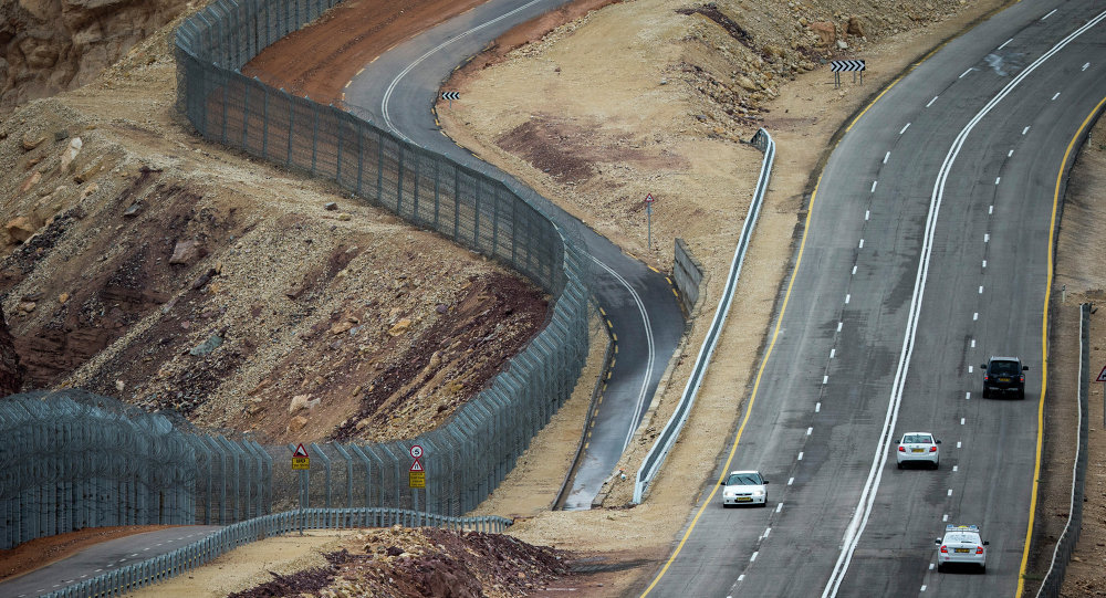 A picture taken on March 9, 2014 shows a general view of the fencing along the southern Israeli border with Egypt near the Red Sea resort of Eilat