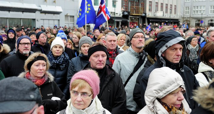 People rally during a protest against the Icelandic government's decision not to start negotiations with the European Union about joining the bloc, in Reykjavik