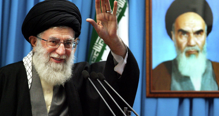 Iranian supreme leader Ayatollah Ali Khamenei waves to the worshippers.