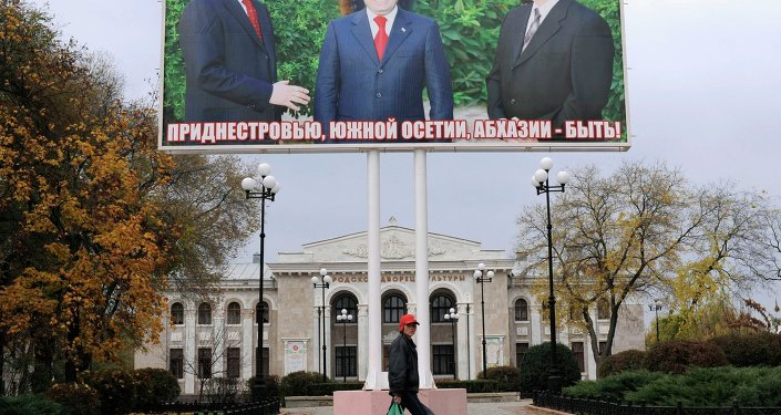 A billboard shows the leaders of Abkhazia Sergei Bagaps (L), South Ossetia Eduard Kokity (C) and Trans-Dniester Igor Smirnov (R) together in Tiraspol