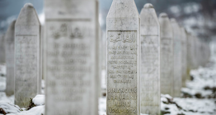 This photo taken on Saturday, March 7, 2015 in the memorial cemetery Potocari, outside Srebrenica, 150 kms northeast of Sarajevo shows the gravestone of Muriz Sinanovic. Sinanovic was among the 8,000 Muslim Bosniak men and boys killed in July 1995 Srebrenica massacre