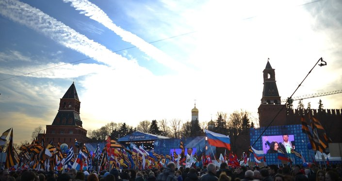 Rally and concert on Vasilyevsky Slope to mark anniversary of Crimea's reunification with Russia.