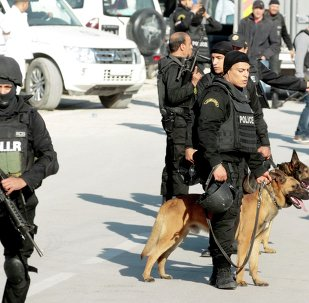 Police lead their dogs during the attack by gunmen on Tunisia's national museum in Tunis March 18, 2015.