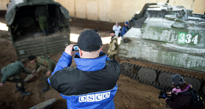 An international monitor of the Organization for Security and Co-operation in Europe (OSCE) shoots video