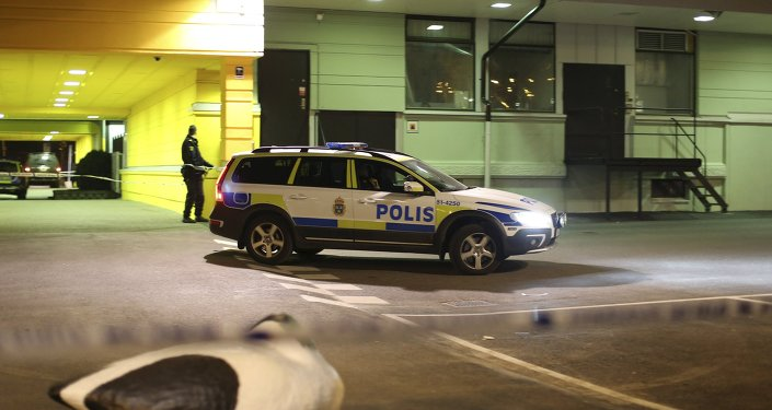 A police officer stands at the scene of a fatal shooting in Gothenburg