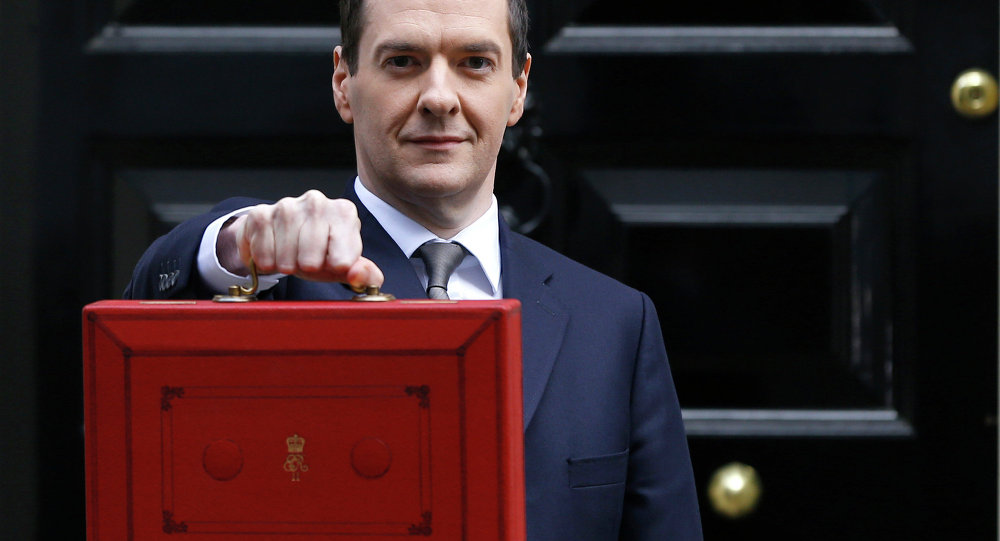 Britain's Chancellor George Osborne poses for the media with the traditional red dispatch box outside his official residence at 11 Downing Street in London