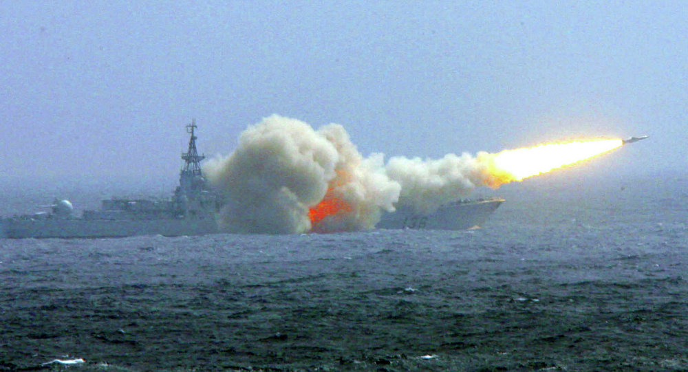 A destroyer of the South China Sea Fleet of the Chinese Navy fires a missile during a training exercise.