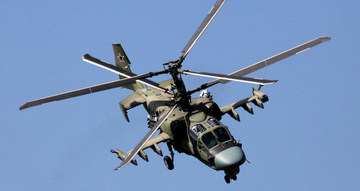 A KA-52 Alligator helicopter in a demo flight during the celebration of the Progress aviation plant's 75th anniversary