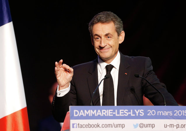 Current UMP right-wing opposition party President and former French President, Nicolas Sarkozy speaks during a campaign rally ahead of the French departmental elections, on March 20, 2015 in Dammarie-les-Lys, south of Paris